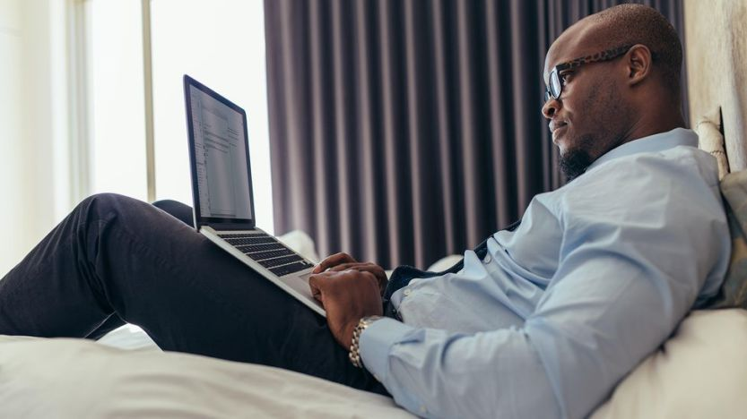 Not only does working from your bed spell potential ergonomic disaster, but it can rewire your brain to disassociate your bed with sleep (Credit: Alamy)