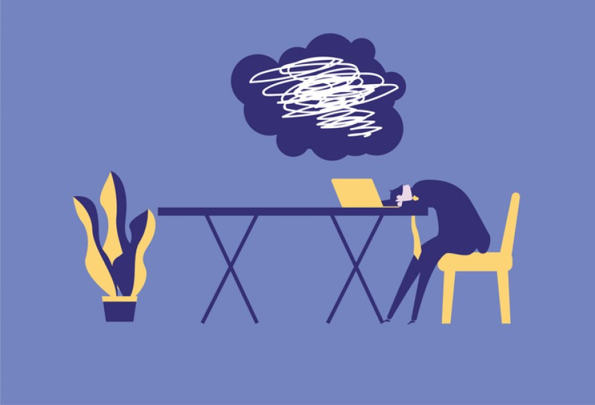 illustration of person with head on their desk at work, unable to think clearly