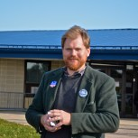 Abel Collins, Candidate for South Kingstown Town Council outside Matunuck Elementary School in November. Collins won a seat on the council and was voted in as Town Council President. (Photo Credit Tracey C. O'Neill)