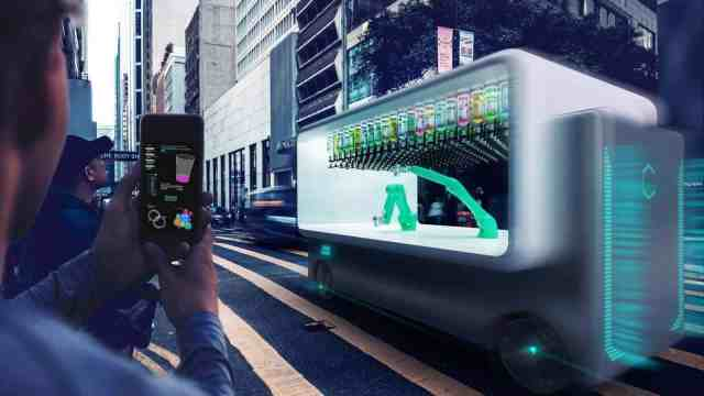 Carlo Ratti's Guido offers drinks to individuals in busy urban areas.