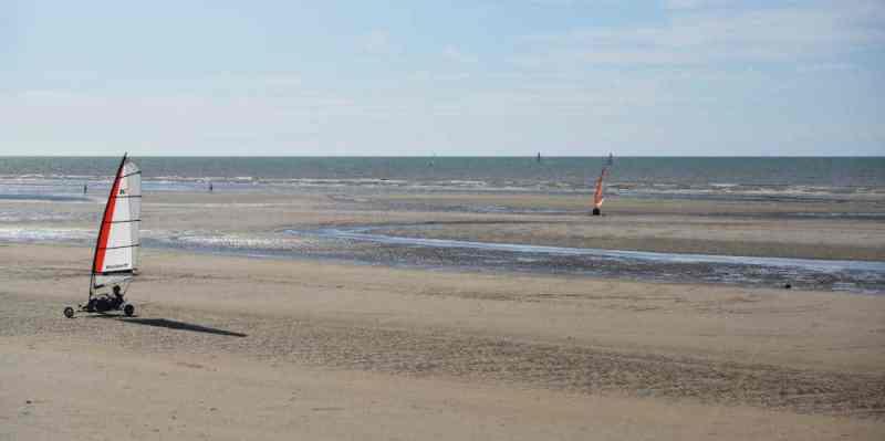 Car sailing on the beach in De Panne