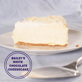 Bailey's #WhiteChocolate #Cheesecake with Almond Brown Sugar Crust. It's made with Bailey's Irish Cream so it's perfect for #StPatricksDay. For the full #recipe, visit OnlyTasteMatters.com.