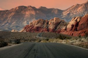 Red Rock Canyon – This impossibly vibrant landscape looks like it jumped off an artist's canvas and settled down in the middle of Nevada. Located only about a half an hour from the Las Vegas strip, Red Rock Canyon is a must-see for both gamblers and non-gamblers. Photo credit: Andy Herbon