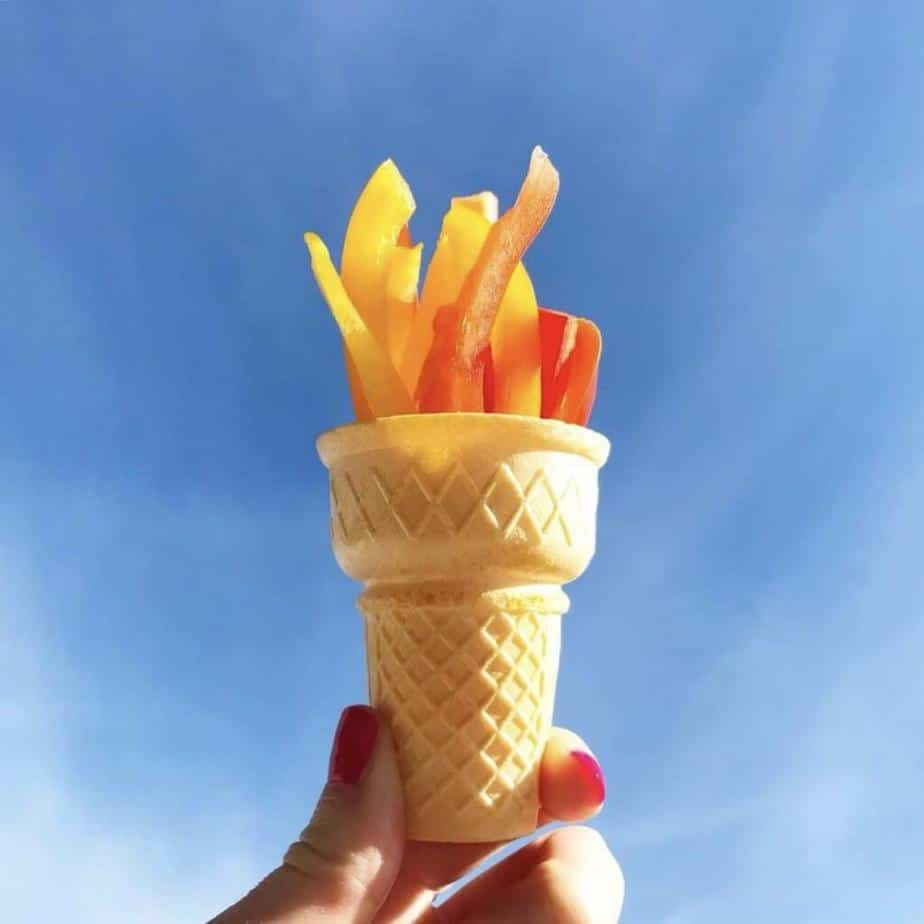 bell pepper slices in an ice cream cone held up to look like an Olympic torch snack