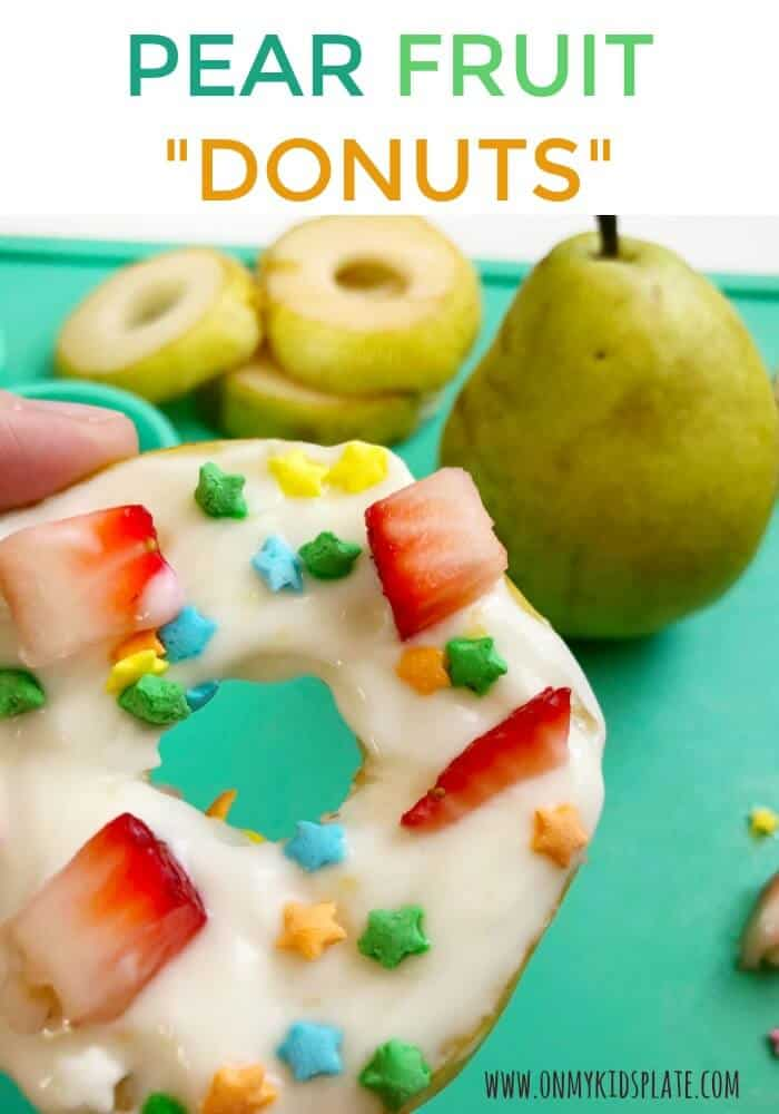 A pear decorated with fruit and sprinkles to look like a donut with text title overlay
