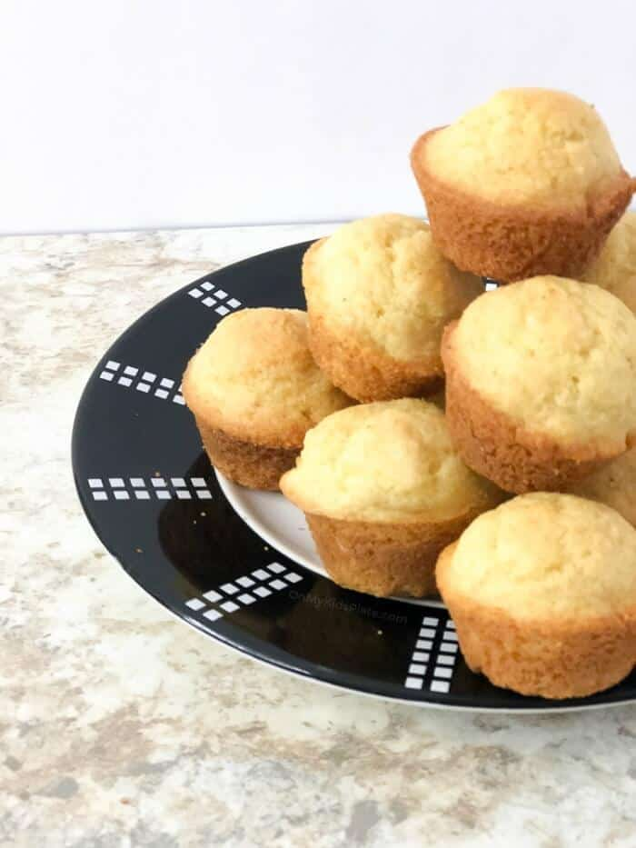 A side view of a plate piled high with sweet cornbread muffins