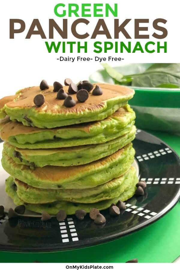A stack of green pancakes topped with chocolate chips and fresh spinach in the background with text title overlay