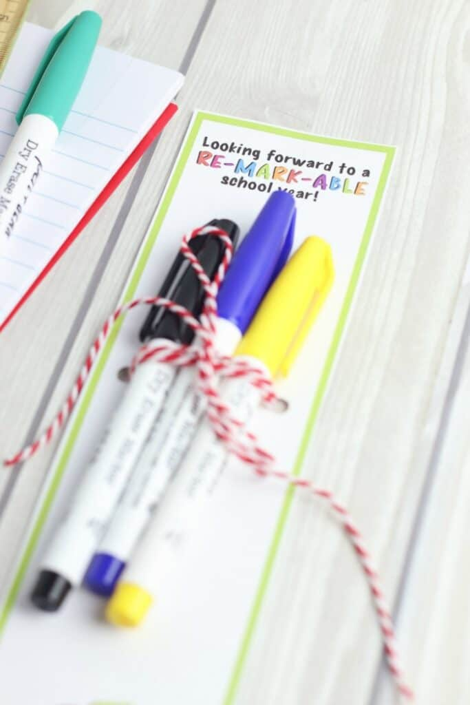 """Markers tied to a gift tag that says \""""looking forward to a re-mark-able\"""" school year"""