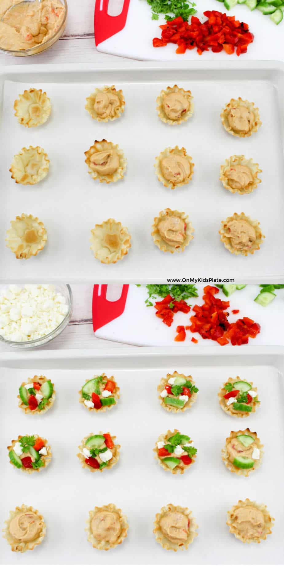 Phyllo cups being filled with hummus, then topped with chopped red pepper, cucumber and parsley from a cutting board and feta cheese from a bowl.