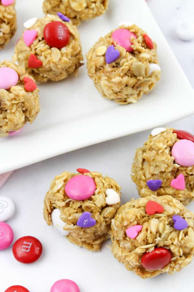 Snack bites decorated with candies and sprinkles in Valentine\'s Day colors
