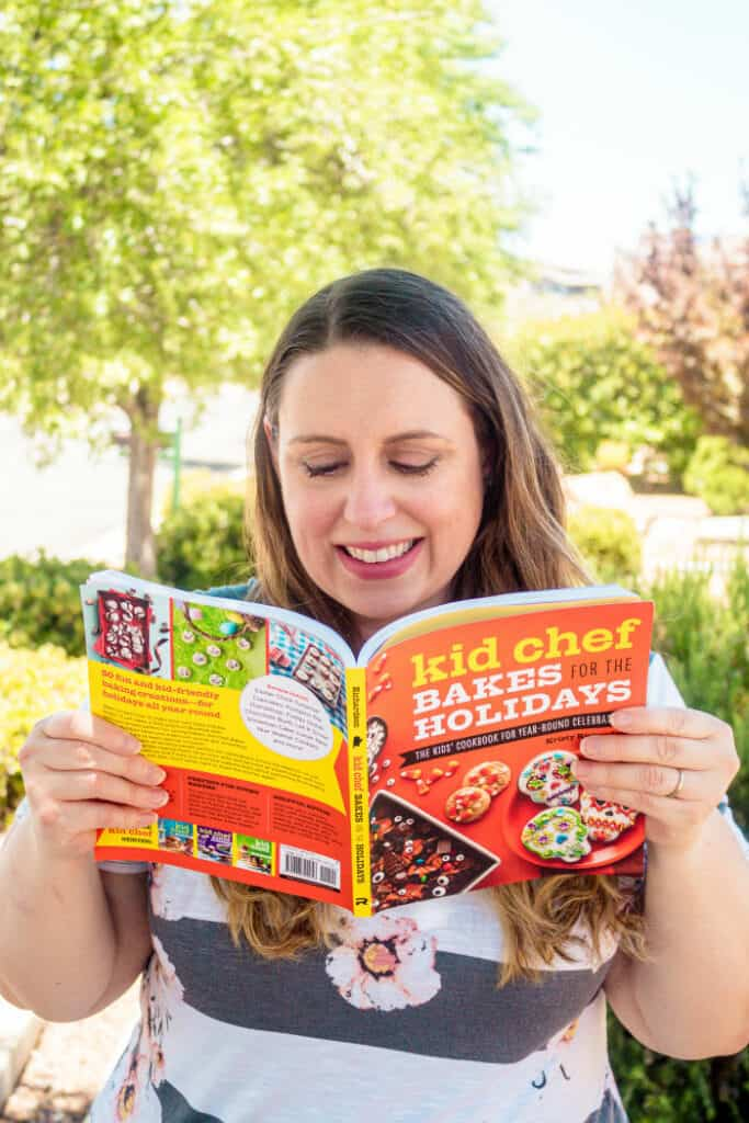 Cookbook author Kristy Richardson reading Kid Chef Bakes For The Holidays