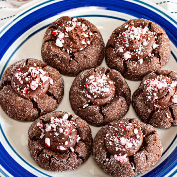 Peppermint chocolate thumbprint cookies on a plate to share
