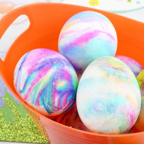 Close up of Easter Eggs swirled with color in a basket