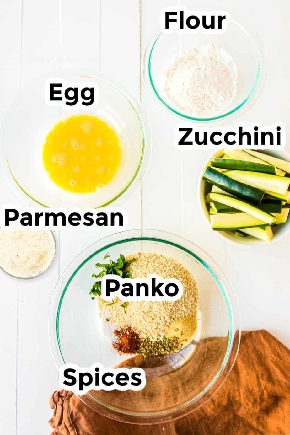 Ingredients in bowls for Parmesan Garlic Zucchini Fries