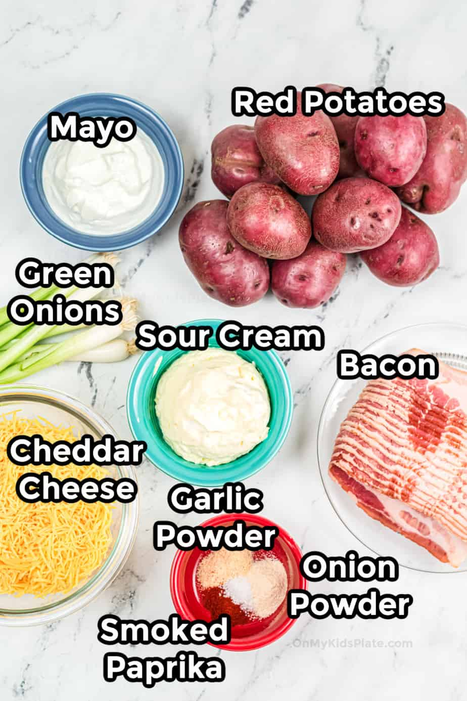 Ingredients for loaded potato salad in bowls.