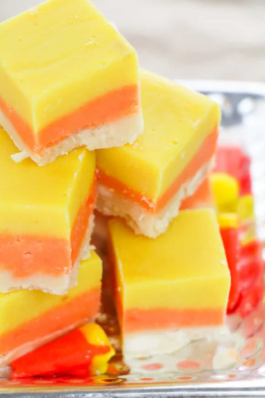Layered yellow orange and white fudge to look like candy corn