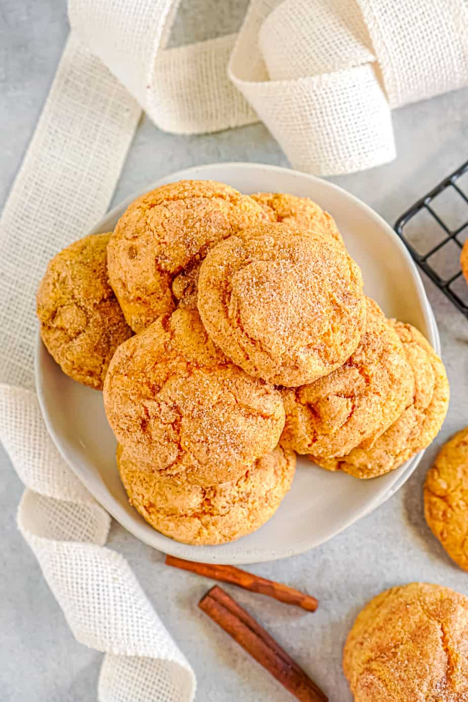Pumpkin snickerdoodle cookies on a plate