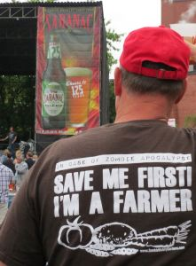 "Here's the GrassWhisperer out enjoying one of the Saranac Thursday concerts, made possible by good planning and writing in time for fun on his grazing chart!  Kathy says, ""Thanks for showing off my Zombie Victory Gardens T-shirt!"""