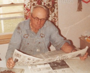 Kathy's Grandpa Voth checks the news at lunchtime while listening to the market prices on the radio.