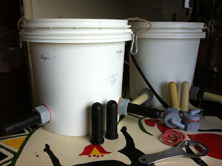 Buckets and nipples for feeding calves