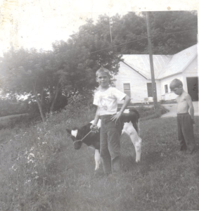 Here's Lyle with his first love.  At 9, his uncle drove up and gave him the key to the trunk of the car. He opened the trunk and took out Bangs, a newborn calf. Lyle raised her for almost two years, and then she went back to his uncle's farm.