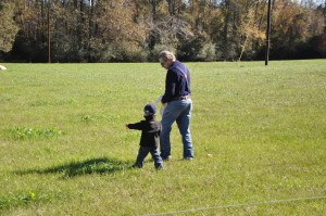 Don showing his pasture to a future farmer.