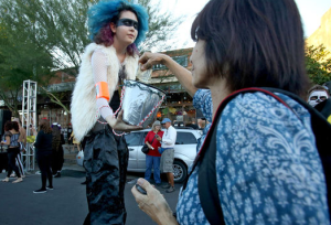"This is a ""Hungry Ghost"" one of many volunteers collecting donations along the route. For more pictures of the event, click and head to the Arizona Daily Star's gallery of photos."