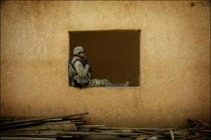 Soldier Sitting In Window