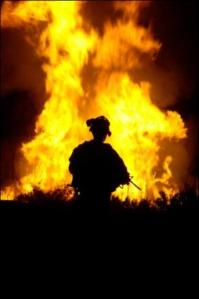Soldier Watching Flames