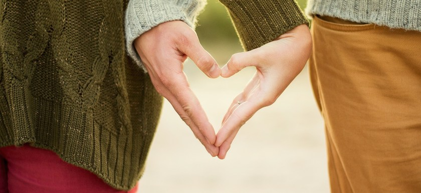Close up of a couple holding hands. Photo.