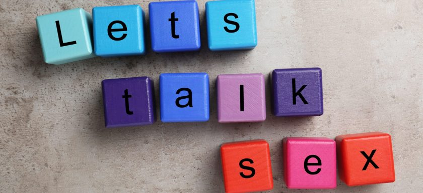 Coloured beads spell out 'lets talk sex'. Photo.