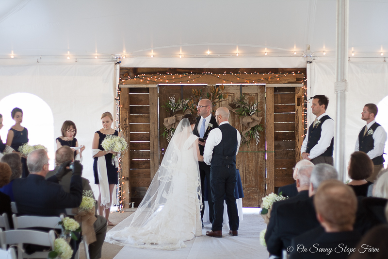 indoor ceremony setup under tent on sunny slope farm-11