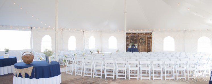 indoor ceremony setup under tent on sunny slope farm-2