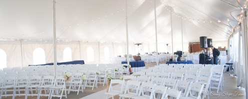 indoor ceremony setup under tent on sunny slope farm-9