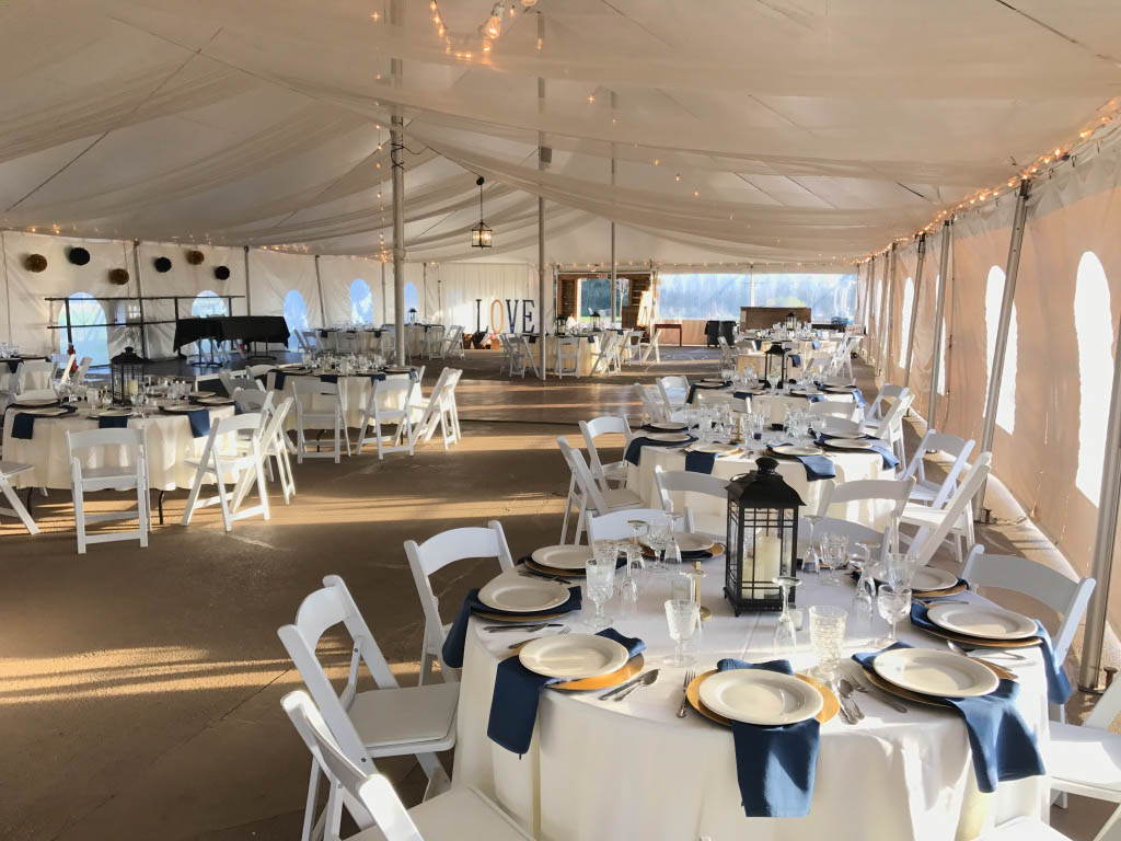 and the reception tent is pristine and every table is perfectly set for your wedding day!