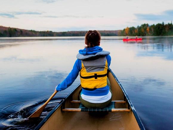 Woman paddling Algonquin Park lake