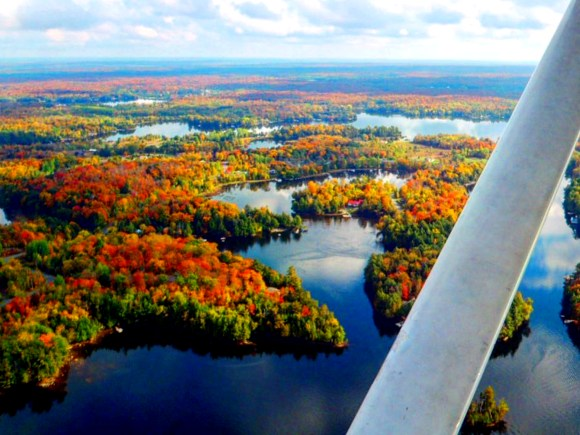Scenic view of fall colour and lakes of Muskoka from floatplane