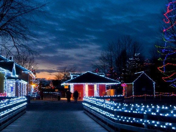 Streets of Upper Canada Village lit up in festive, colourful lights