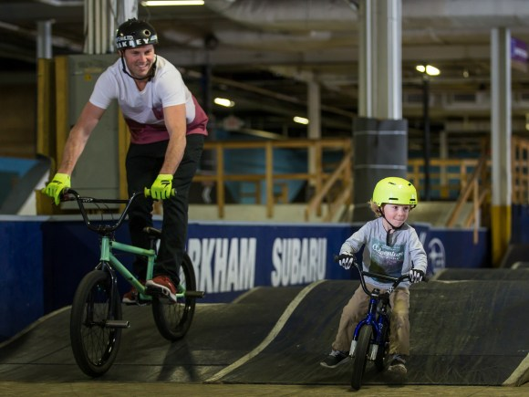 Adult and child having fun at Joyride 150 Indoor Park