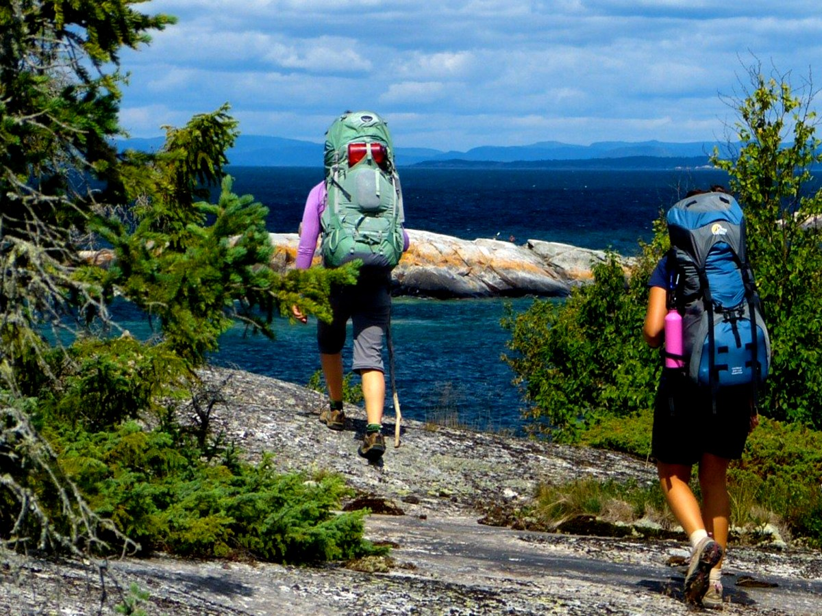 Two women hiking along the coast of Lake Superior