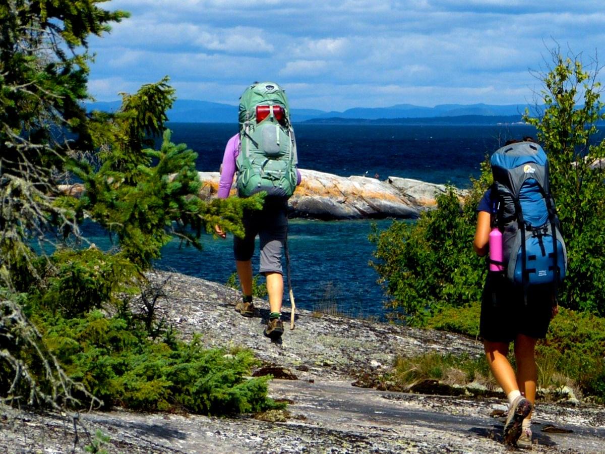 Two women hiking along the coast of Lake Superior