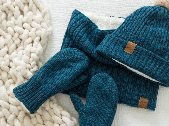 A set of blue mitts, scarf and hat