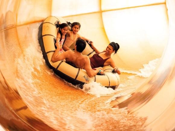 family in tube in indoor waterpark