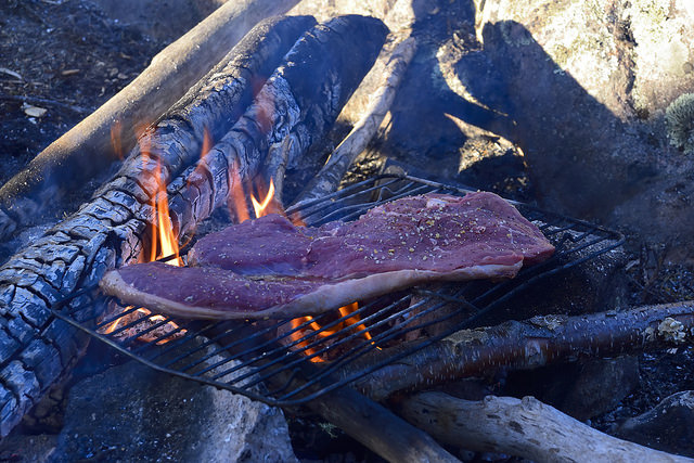 Nothing says camping like meat on open fire.