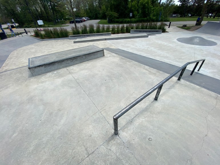 holland landing skatepark from the corner with the across and down rail