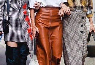 جاذبية المرأة وأناقتها مع ارتداء التنورة الميدي مع البوت بأناقة هذا الشتاء