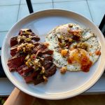 Steak and eggs topped with charred salsa