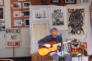 A Non-Violent musician performing at the River Garden for a Brown Bag Lunch.