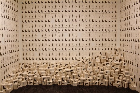 Linda Bond's epic portrayal of the guns that went missing in Iraq, filling the walls and the room.