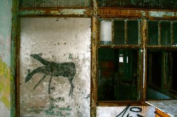Double-headed Spirit Deer pointing the way through the door toward the roof.